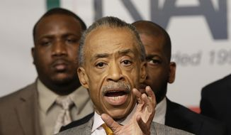 The Rev. Al Sharpton is surrounded by other civil rights leaders while he speaks during a news conference at the National Action Network headquarters in New York, Thursday, Dec. 4, 2014. (AP Photo/Seth Wenig) ** FILE **