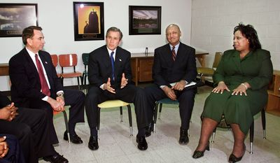 George W. Bush talks about renewing 1996 welfare reform with, from left: HHS Secretary Tommy Thompson, community development leader Robert L. Woodson, Sr., Pastor Shirley Holloway. (AP Photo/J.Scott Applewhite)