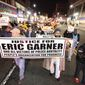 Hundreds of people march in the streets of Newark, N.J. to protest police brutality and the previous day's decision to not indict the New York City police officer involved in the death of Eric Garner in Staten Island on Thursday, Dec. 4, 2014. (AP Photo/The Record of Bergen County - Northjersey.com, Kevin R. Wexler)