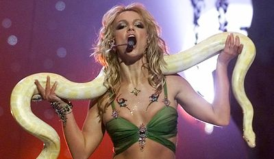 FILE - In this Sept. 6, 2001, file photo, Britney Spears performs with a snake during the finale of the MTV Video Music Awards in New York. (AP Photo/Beth A. Keiser, file)