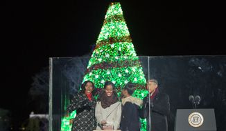 President Obama, first lady Michelle Obama and daughters Malia and Sasha participate in the National Christmas Tree lighting ceremony Thursday. (AP Photo/Pablo Martinez Monsivais)