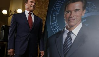 In this photo taken Monday Sept. 8, 2014, former Gov.Arnold Schwarzenegger stands next to his official portrait, done by Austrian artist Gottfried Helnwin, after it was unveiled at the Capitol in Sacramento, Calif. The portrait  of the two-term Republican governor  was hung on the third floor of the Capitol, Friday Dec. 5, after Helnwein touched up a smudge on the painting, seen on the right lapel, that had once featured the face of Schwarzenegger's wife Maria Schriver. (AP Photo/Rich Pedroncelli)