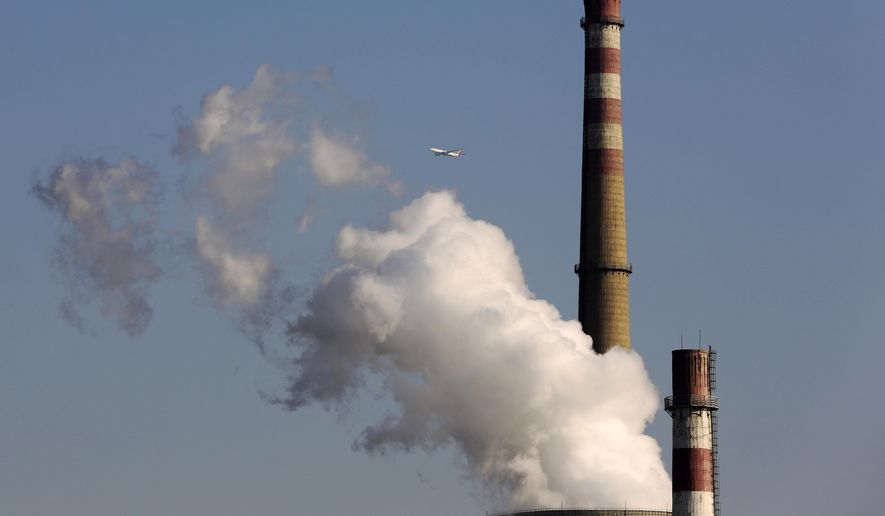 """To avoid the economic, social, environmental and human health catastrophes that would follow fossil fuel elimination, we would need affordable, reliable options on a large enough scale to replace them. Existing """"renewable"""" technologies cannot possibly do that. (AP Photo/Andy Wong, File)"""