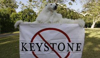 A member of the Center for Biological Diversity in polar bear costume protests the Keystone XL pipeline on May 7, 2014, during a visit by President Barack Obama for a two-day visit to Los Angeles for two political fundraisers. The Keystone XL pipeline would cross Montana, South Dakota and Nebraska, where it would connect with existing pipelines to reach refineries on the Texas Gulf Coast. The Obama administration announced last month it was delaying a decision on the pipeline's fate indefinitely. (Associated Press) **FILE**