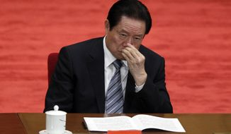 In this photo taken May 4, 2012, Zhou Yongkang, Chinese Communist Party Politburo Standing Committee member in charge of security, attends a conference to celebrate the 90th anniversary of the founding of Chinese Communist Youth League at the Great Hall of the People in Beijing. China's official Xinhua News Agency says the country's former security chief, Zhou Yongkang, has been expelled from the Communist Party. Xinhua said the decision was made Friday Dec. 5, 2014 at a meeting of the Political Bureau of the party's Central Committee. (AP Photo/Alexander F. Yuan, File)