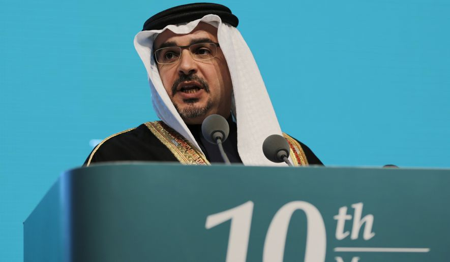 Bahraini Crown Prince Salman bin Hamad Al Khalifa addresses delegates at the opening session of the 10th Regional Security Summit held by the  International Institute for Strategic Studies, in Manama, Bahrain, Friday, Dec. 5, 2014. Senior ministers from Britain, France, Egypt, Iraq and the United Arab Emirates are among the participants, who are expected to discuss regional security and countering extremism, including efforts to fight the Islamic State group. (AP Photo/Hasan Jamali)