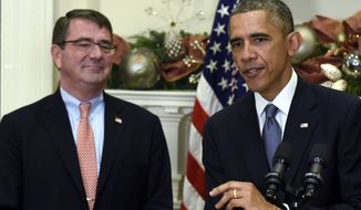 President Barack Obama speaks as Ashton Carter, his nominee for defense secretary, listens during the announcement, Friday, Dec. 5, 2014, in the Roosevelt Room of the White House in Washington. (AP Photo/Susan Walsh)