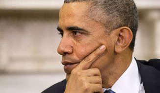 President Barack Obama listens as Jordan's King Abdullah II speaks during their meeting, Friday, Dec. 5, 2014, in the Oval Office of the White House in Washington. The leaders discussed topics including ISIL, Syria, and refugees. (AP Photo/Jacquelyn Martin)