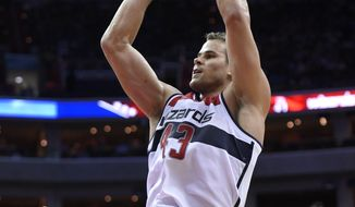 Washington Wizards forward Kris Humphries (43) shoots during the second half of an NBA basketball game against the Denver Nuggets, Friday, Dec. 5, 2014, in Washington. (AP Photo/Nick Wass)
