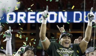 Oregon players celebrate the 51-13 win over Arizona at the end of a Pac-12 Conference championship NCAA college football game Friday, Dec. 5, 2014, in Santa Clara, Calif. (AP Photo/Ben Margot)