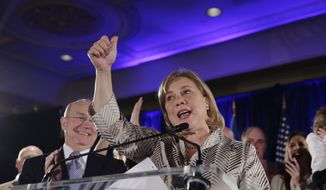 Sen. Mary Landrieu, D-La., speaks to supporters as she concedes defeat in her Senate runoff election against Rep. Bill Cassidy, R-La., in New Orleans, Saturday, Dec. 6, 2014. Left is her husband Frank Snellings. (AP Photo/Gerald Herbert)