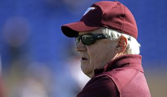 Virginia Tech head coach Frank Beamer watches prior to an NCAA college football game against Duke in Durham, N.C., Saturday, Nov. 15, 2014. (AP Photo/Gerry Broome)