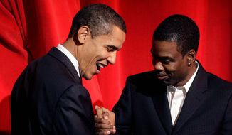 Democratic presidential hopeful Sen. Barack Obama, D-Ill., left, greets comedian Chris Rock, right, after Rock introduced Obama at The Apollo Theater in the Harlem section of New York, Thursday, Nov. 29, 2007.  (AP Photo/Seth Wenig)