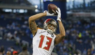 Tampa Bay Buccaneers wide receiver Mike Evans (13) runs through pre-game drills before an NFL football game against the Detroit Lions in Detroit, Sunday, Dec. 7, 2014. (AP Photo/Paul Sancya)