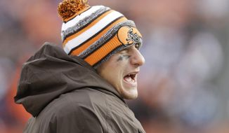 Cleveland Browns quarterback Johnny Manziel watches from the sidelines in the third quarter of an NFL football game against the Indianapolis Colts Sunday, Dec. 7, 2014, in Cleveland. (AP Photo/Tony Dejak)