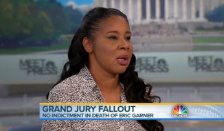 "Eric Garner's widow, Esaw, said Sunday that she believes her husband was ""murdered unjustly"" by New York police, but she doesn't think race was a contributing factor in his death. (NBC News)"