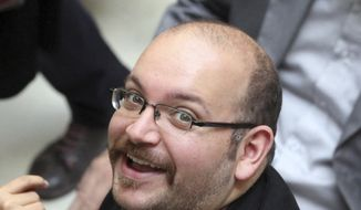 Jason Rezaian, an Iranian-American correspondent for The Washington Post, has been detained and unspecified charges have been leveled against him by Iran.  (AP Photo/Vahid Salemi, File)