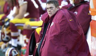 Washington Redskins quarterback Colt McCoy (16) sits on the bench during the first half of an NFL football game against the St. Louis Rams in Landover, Md., Sunday, Dec. 7, 2014. (AP Photo/Mark Tenally)