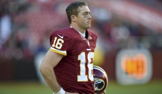 Washington Redskins quarterback Colt McCoy (16) stands on the sidelines during the second half of an NFL football game against the St. Louis Rams in Landover, Md., Sunday, Dec. 7, 2014. The Rams defeated the Redskins 24-0. (AP Photo/Nick Wass)
