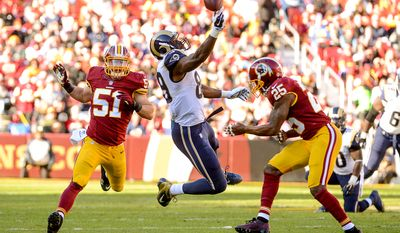 Washington Redskins free safety Ryan Clark (25), right, is called for unnecessary roughness as he tackles St. Louis Rams tight end Jared Cook (89) as he can't hold onto a pass in the first quarter as the Washington Redskins play the St. Louis Rams in NFL football at FedExField, Landover, Md., Sunday, December 7, 2014. (Andrew Harnik/The Washington Times)