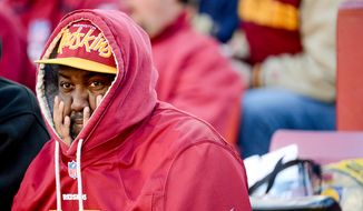 A Washington Redskins fan watches as the Washington Redskins play the St. Louis Rams in NFL football at FedExField, Landover, Md., Sunday, December 7, 2014. (Andrew Harnik/The Washington Times)