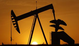 In this Tuesday, March 22, 2012 file photo, a pump jack is silhouetted against the setting sun in Oklahoma City. Declining oil prices could cost Oklahoma residents an income tax cut in 2016. A law signed in April by Gov. Mary Fallin requires an increase in state revenue, provided in part by tax collections that rise and fall with oil prices. (AP Photo/Sue Ogrocki, File)