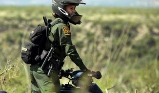 In this undated photo from the U.S. Border Patrol, Crystal A. Diaz, a U.S. Border Patrol agent with the Tucson Sector in Arizona, rides her ATV while on patrol. The Border Patrol is on a hiring spree for a very specific type of agent: a female one. Only 5 percent of its approximately 21,000 agents around the country are women, and the agency has long called this a problem. It is especially troublesome in the Southwest, where nearly 120,000 women were caught crossing the border illegally in the fiscal year that ended Oct. 31. That's a significant increase from fiscal year 2011, when about 43,000 women were apprehended. (AP Photo/U.S. Border Patrol)