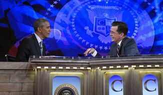 President Barack Obama talks with Stephen Colbert of The Colbert Report during a taping of the program in Lisner Auditorium at George Washington University in Washington, Monday, Dec. 8, 2014. (AP Photo/Susan Walsh)