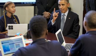 """President Barack Obama talks with students during an """"Hour of Code"""" event in the Eisenhower Executive Office Building on the White House complex in Washington,  Monday, Dec. 8, 2014, attended by  middle-school students from Newark, N.J. (AP Photo/Jacquelyn Martin)"""