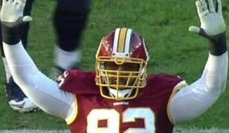Washington Redskins nose tackle Chris Baker posted this photo, a screengrab of the Fox television broadcast, on his Instagram page on Sunday, Dec. 7, 2014. Baker was celebrating a sack by putting his hands up, showing his support for those who have been victims of perceived racial inequality in several high-profile crimes in recent months.