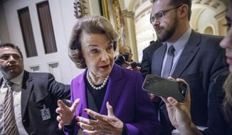 """Senate Intelligence Committee Chair Sen. Dianne Feinstein, D-Calif. speaks to reporters on Capitol Hill in Washington, Tuesday, Dec. 9, 2014, as she leaves the Senate chamber after releasing a report on the CIA's harsh interrogation techniques at secret overseas facilities after the 9/11 terror attacks. Feinstein  branded the findings a """"stain on the nation's history."""" (AP Photo/J. Scott Applewhite)"""