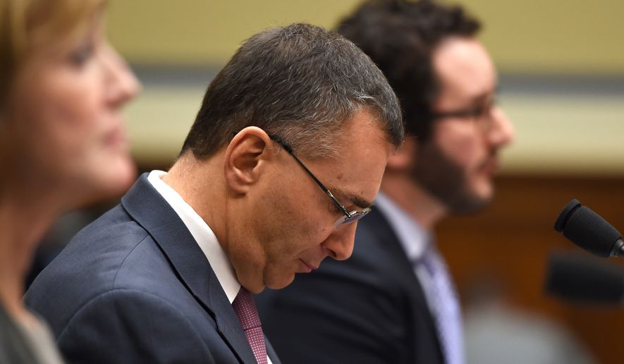 MIT economist Jonathan Gruber listens on Capitol Hill in Washington, Tuesday, Dec. 9, 2014, as he testified before the House Oversight Committee health care hearing. (AP Photo/Molly Riley)