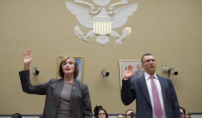 MIT economist Jonathan Gruber, right, is sworn in prior to testifying before a House Oversight Committee health care hearing in December, 2014. (AP Photo/Molly Riley)
