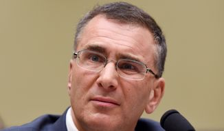 "MIT economist Jonathan Gruber listens as he testifies on Capitol Hill in Washington, Tuesday, Dec. 9, 2014, before the House Oversight Committee health care hearing. Congressional Democrats charged Tuesday that Republicans are seizing on a health adviser's self-described ""thoughtless"" and misleading remarks to attack President Barack Obama's signature health care law.  (AP Photo/Molly Riley)"