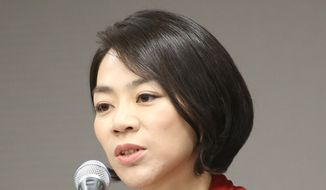 In this September 2014 photo, Cho Hyun-ah, Korean Air's vice president responsible for cabin service and the oldest child of Korean Air chairman Cho Yang-ho, answers reporters' question during a news conference in Incheon, west of Seoul, South Korea. Korean Air Lines apologized Tuesday, Dec. 9, 2014, for inconveniencing passengers after Cho ordered a crew member off a flight for serving bagged nuts in the first class cabin. (AP Photo/Yonhap)