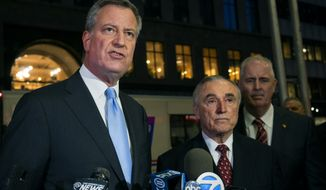 New York City Mayor Bill de Blasio, left, discusses investigation details Tuesday, Dec. 9, 2014, in New York, along with New York City Police Commissioner William Bratton, center, and Chief of Detectives Robert Boyce, after an incident in the early morning hours in which a man with a history of mental illness slipped into the headquarters of a major Jewish organization in the Brooklyn borough and stabbed an Israeli student in the head as he was studying in the library. (AP Photo/Craig Ruttle) ** FILE **