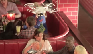 A Brooklyn photojournalist reportedly had a piece of her nose severed off by a wayward drone carrying mistletoe during a promotional event at TGI Friday's. (YouTube/TGI Friday's)