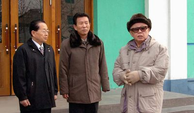 In a photo released by Korea News Service on Saturday, Feb. 14, 2009, in Tokyo, North Korean leader Kim Jong Il, right, talks to officials during his inspection of the Wonsan Chemical Factory in Wonsan, Kongwon Do, North Korea. (AP Photo/Korean Central News Agency via Korea News Service, File)