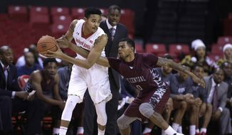 Maryland guard/forward Jared Nickens, left, tries to keep the ball away from North Carolina Central guard Dante Holmes in the first half of an NCAA college basketball game, Wednesday, Dec. 10, 2014, in College Park, Md. (AP Photo/Patrick Semansky)