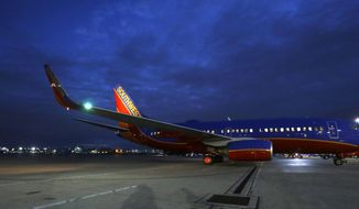 In this Nov. 13, 2014 photo, a Southwest Airlines originator flight pulls from the gate for departure from Love Field in Dallas. Throughout the airline industry, the first flight of the day sets the tone for keeping the system's flights running on-time. (AP Photo/LM Otero)