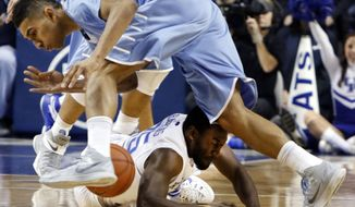 Kentucky's Dominique Hawkins, bottom, and Columbia's Maodo Lo  struggle with a loose ball during the first half of an NCAA college basketball game, Wednesday, Dec. 10, 2014, in Lexington, Ky. (AP Photo/James Crisp)