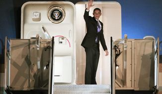 President Barack Obama boards Air Force One after a visit to Nashville, Tenn., Tuesday, Dec. 9, 2014. Obama went to the Casa Azafran community center and delivered remarks and answered questions regarding immigration reform. (AP Photo/Mark Humphrey)