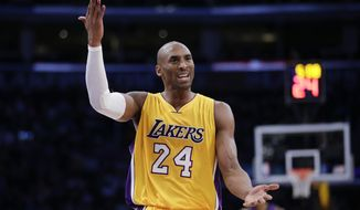 Los Angeles Lakers' Kobe Bryant gestures while arguing with a referee during the first half of an NBA basketball game against the Sacramento Kings, Tuesday, Dec. 9, 2014, in Los Angeles. (AP Photo/Jae C. Hong)