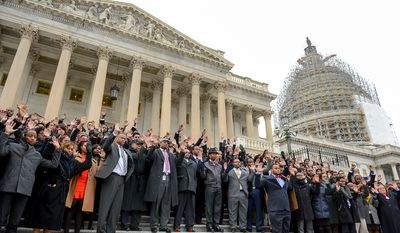 African American Congressional staffers hold a protest on the House steps of the U.S. Capitol Building to protest the Eric Garner and Mike Brown grand jury decisions, Washington, D.C., Thursday, December 11, 2014. (Andrew Harnik/The Washington Times)