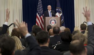 Members of the media raise their hands during CIA Director John Brennan's news conference at CIA headquarters in Langley, Va., Thursday, Dec. 11, 2014. Brennan defending his agency from accusations in a Senate report that it used inhumane interrogation techniques against terrorist suspect with no security benefits to the nation. (AP Photo/Pablo Martinez Monsivais)