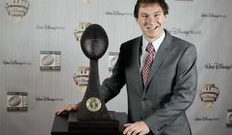 Maryland's Brad Craddock stands with his trophy after being awarded the Lou Groza Collegiate Placekicker Award at the College Football Awards, Thursday, Dec. 11, 2014, at in Lake Buena Vista, Fla. (AP Photo/John Raoux)