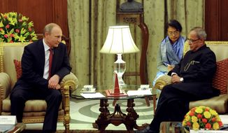 Russian President Vladimir Putin, left, and Indian President Pranab Mukherjee meet in New Delhi, India, Thursday, Dec. 11, 2014. Facing a stumbling economy at home and increasingly biting Western sanctions, Russian President Vladimir Putin sought Thursday to strengthen once-close relationship with India through an ambitious plan to help New Delhi build at least 12 new nuclear reactors. (AP Photo/RIA Novosti Kremlin, Mikhail Klimentyev, Presidential Press Service)