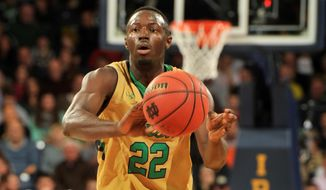 Notre Dame guard Jerian Grant throws a pass in the first half of an NCAA basketball game with Florida State Saturday, Dec., 13, 2014 in South Bend, Ind. (AP Photo/Joe Raymond)