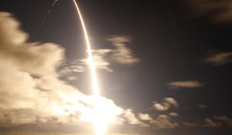 United Launch Alliance Atlas V rocket carrying a National Reconnaissance Office satellite launches from Space Launch Complex-3 at Vandenberg Air Force Base Friday, Dec. 12., 2014. (AP Photo/