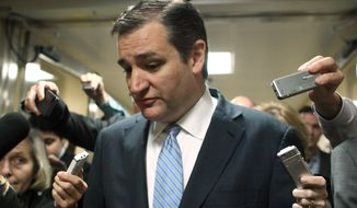Sen. Ted Cruz, R-Texas talks with reporters on Capitol Hill in Washington, Friday, Dec. 12, 2014. (Associated Press) ** FILE **